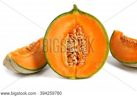 Half Of The Cantaloupe Melon And A Piece Of Melon Are Isolated On A White Background.