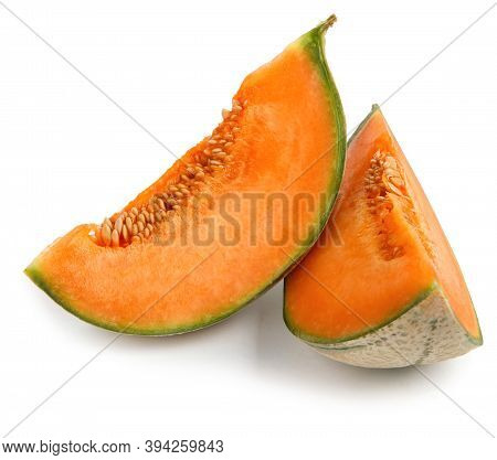 Two Pieces Of Melon Are Isolated On A White Background. Cantaloupe Melon.