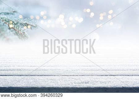 Empty Frosty Wooden Boards With Fir Branch And Atmospähric Bokeh. Background With Short Depth Of Fie