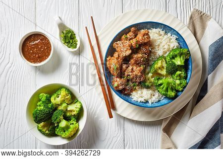 General Tso's Chicken Crispy Chinese Chicken Bites In A Bowl With Rice And Steamed Broccoli Florets,