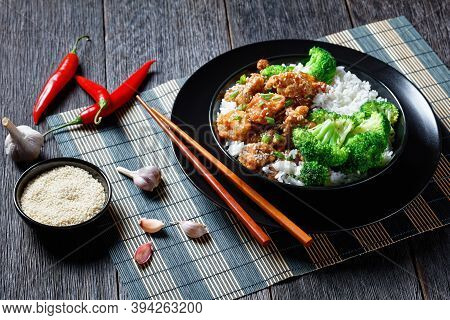 General Tso's Chicken Crispy Chinese Chicken Bites In A Black Bowl With Rice And Steamed Broccoli Fl