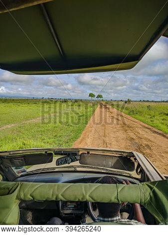 Mikumi, Tanzania - December 6, 2019: View From The Passenger Seat From Above, Sitting In A Safari Je