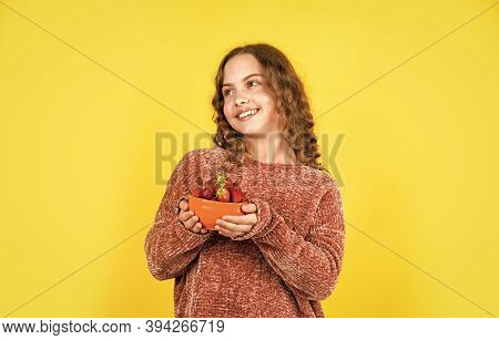 Vitamin Concept. Summer Berries. Girl Eating Homegrown Strawberry. Healthy Food. Health Care. Health