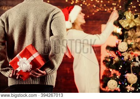 Generosity And Kindness. Prepare Surprise. Winter Surprise. Man Carry Gift Box Behind Back Defocused