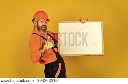 Visual Outline. Repairman Hold Whiteboard Copy Space. Handsome Repairman. Architect Showing Project.