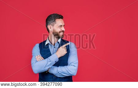 Look At This. Happy Man Point Index Finger Red Background. Objective Pointing. Hand Gesture. Marketi