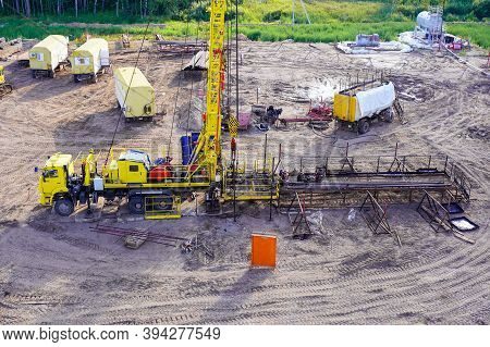 Special Equipment For Drilling An Oil Well In An Oil Field. Workover Rig Working On A Previously Dri