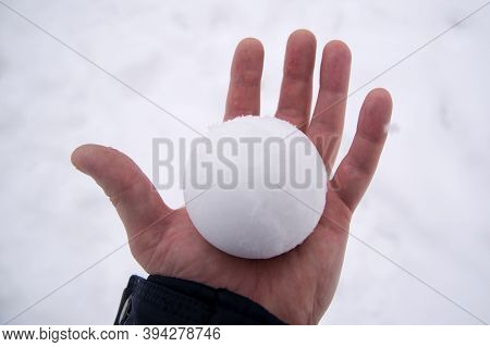 Snowball In Bare Hand. Snowball Melts In Bare Hand