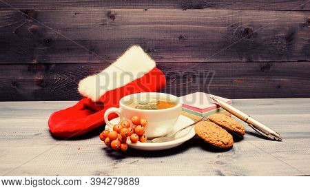 Health Care Folk Remedies. Ceramic Cup Hot Fresh Brewed Tea Beverage. Cup Of Tea On Blue Background