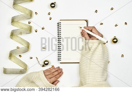 Writing A Letter To Santa Clause. Woman Writing New Year Resolutions On Notepad. Bright Workspace Wi