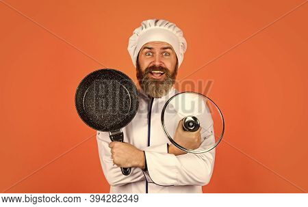 Making Nutritional Choice. Bearded Man Cooking In Kitchen. Culinary And Cuisine. Kitchen Utensils. H