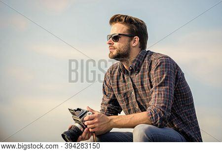 Hipster Photographer. Blogger Shooting Vlog. Handsome Blogger Guy Traveler Retro Camera. Manual Sett
