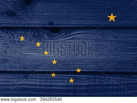 Alaska Flag Painted On Old Wood Plank Background. Brushed Natural Light Knotted Wooden Board Texture