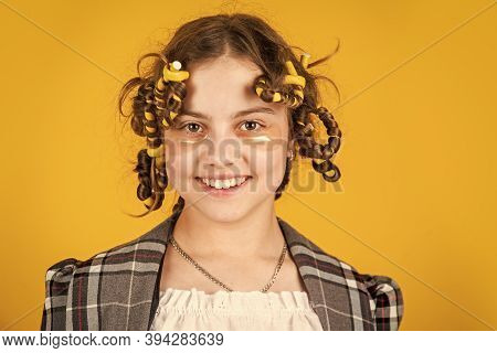 Small Girl Has Hair Curlers Papillotes. Kid Hairdresser Salon. Healthy Long Hairstyle. Hair Care For