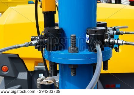 Hydrostatic Crane Engine. Control System Of Hydraulic Hoses On The Crane. Close Up Of Pipe System Of