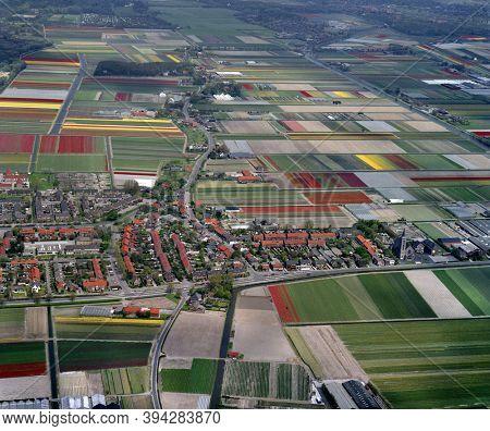 Noordwijkerhout, De Zilk, Holland, May 12 - 1986: Historical aerial photo of the flower fields near Noordwijkerhout and village De Zilk in the province Zuid Holland