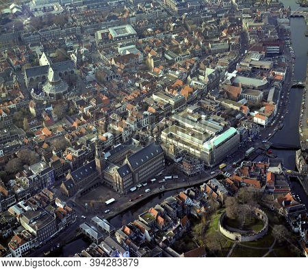 Leiden, Holland, December 3 - 1984: Historical aerial photo of the center of Leiden, Holland with the river Rhine, Burcht, Town hall and Pieters church
