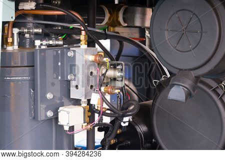 Electrical Power Generator. Powerful Modern Engine With Wires, Hoses And Fittings. Detailed Close Up