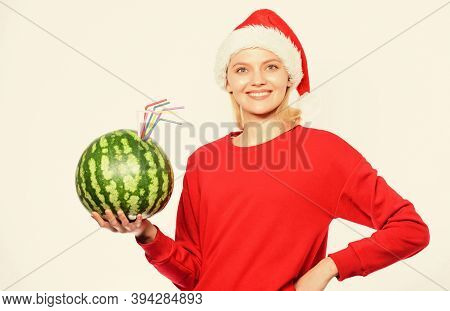 How Detox After Christmas. Winter Vitamin Fruit Ration. Girl Wear Santa Hat Drink Watermelon Vitamin