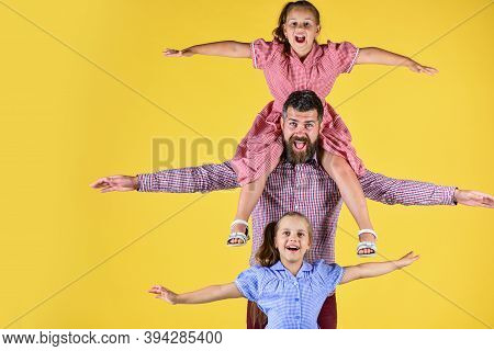 Just Relax. Bearded Father With Two Small Girls. Kids Love Their Dad. Children With Daddy. Internati