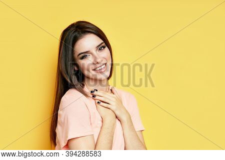 Portrait Of Shy Happy Excited Female On Yellow Background With Copy Space. People Emotions, Facial E