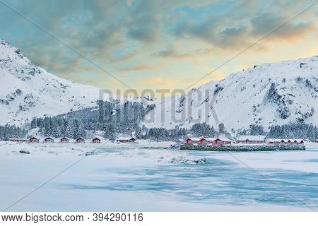 Stunning Winter Scenery With Traditional Norwegian Red Wooden Houses On The Shore Of Rolvsfjord On V