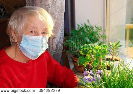 The Covid-19, Health, Safety And Pandemic Concept - Senior Old Lonely Woman Wearing Protective Medic