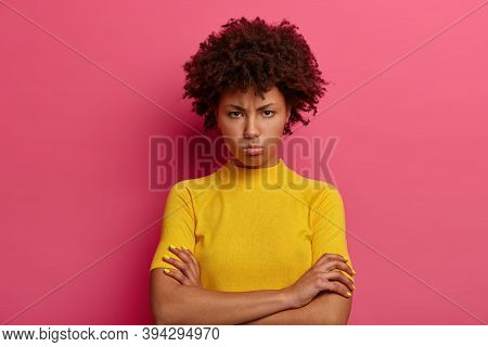 Discontent Woman With Sulking Expression, Keeps Arms Folded, Looks Angrily At Camera, Offended By He