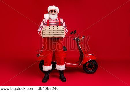 Full Length Photo Of Pensioner Grandpa Moped Hold Pizza Boxes Prepare Deliver Home Client Wear Santa