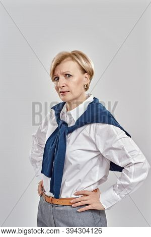 Portrait Of Elegant Middle Aged Caucasian Woman Wearing Business Attire Having A Doubtful Look While