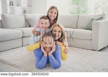 Full Size Photo Of Idyllic Family Mommy And Two Kids Boy Girl Lying On Daddy Carpet In House Indoors