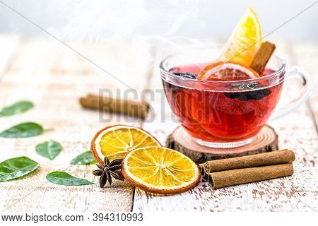 Hot Winter Drink, With Smoke And Steam, Hot Christmas Wine, Drink With Cinnamon, Wine And Citrus Fru