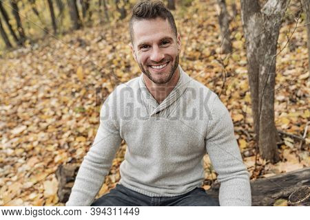 Mature Man On Autumn Leaves Feeling Great