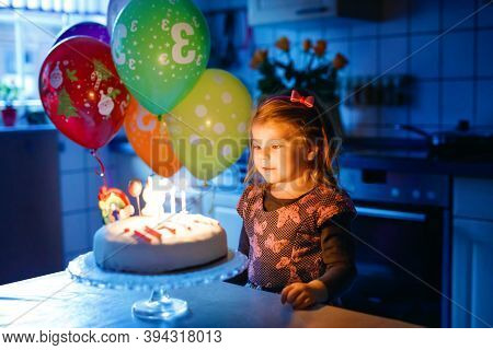 Adorable Little Toddler Girl Celebrating Third Birthday. Baby Toddler Child With Homemade Unicorn Ca