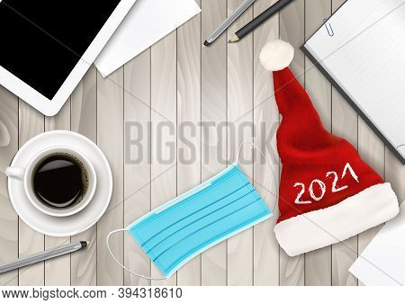 Office Background With Santa Hat, Facial Mask And Office Supplies. Medical Facial Mask As A Symbol F