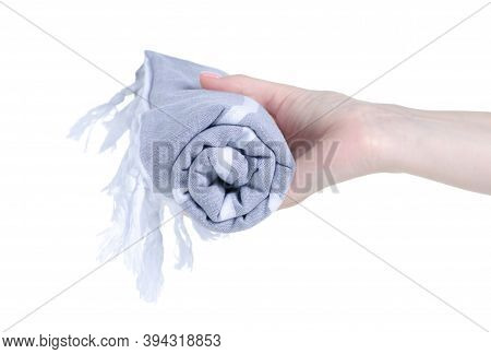 Folded Gray Beach Towel In Hand On White Background Isolation