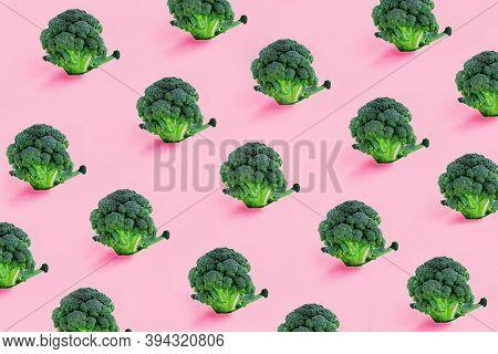 Broccoli On A Pink Background. Seamless Minimalistic Isometric Pattern, Photo Collage, Vegan Pop Art