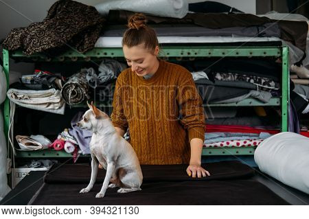 Small Business, Fashion Designer Workplace, Tailoring Shop. Fashion Designer With Pet Dog Working In