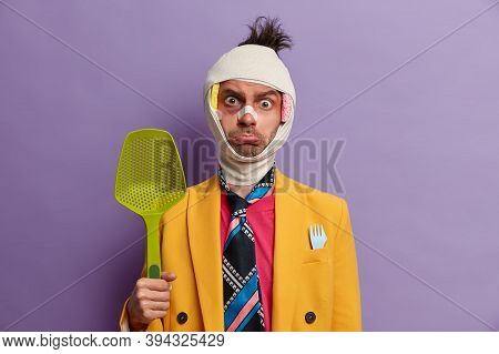 Bruised Displeased Man Ready For Fight And Defence Himself, Poses With Kitchenware, Injured After Fi