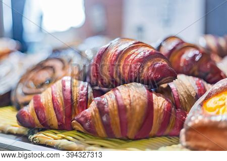 Assortment Of Freshly Baked Croissants For Sale On Counter Of Shop, Market, Cafe Or Bakery - Close U