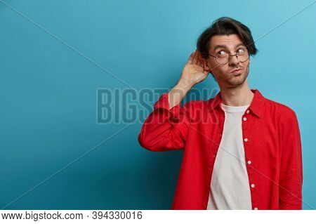 Curious Man Likes Gossips, Wants To Overhear Secret Information, Wears Optical Glasses And Red Shirt