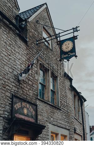 Frome, Uk - October 04, 2020: Sign Outside Sun Inn Pub And Accommodation In Frome, A Market Town In