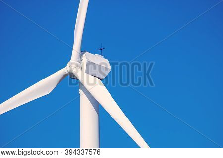 Wind Generator For Generating Renewable Electricity Against A Blue Sky Close-up