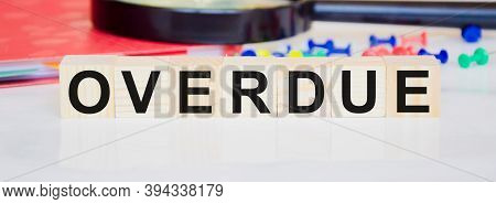 Overdue Invoices Concept. Word Overdue Written On Wooden Cubes
