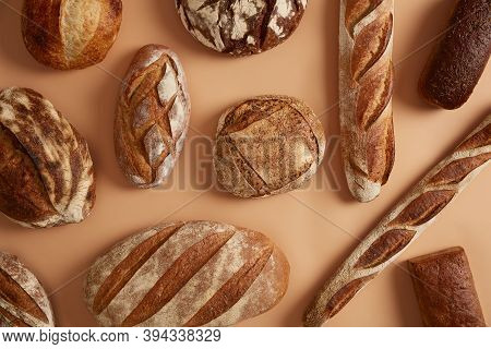 Agriculture Industry, Bakery, Organic Food And Healthy Eating Concept. Different Tasty Breads Made O