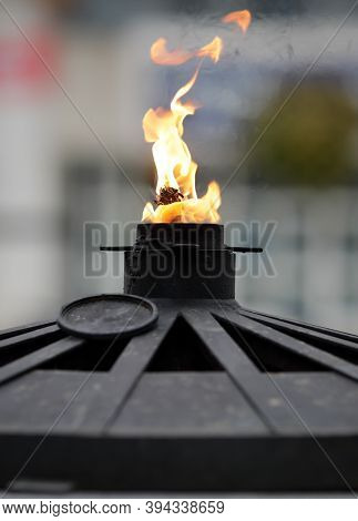 Details With An Oil Fueled Eternal Flame At A War Memorial Monument In Bucharest, Romania.