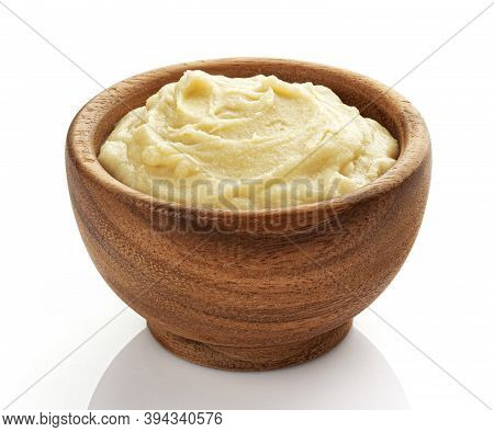 Mashed Potato Puree In Wooden Bowl Isolated On White Background