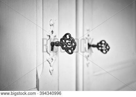 Old Vintage Doors With Antique Skeleton Keys In Lock, Retro Background Texture Black And White Close
