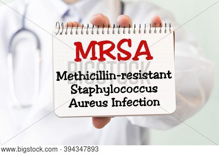 Doctor Holding A Card With Text Mrsa - Methicillin-resistant Staphylococcus Aureus Infection - Medic