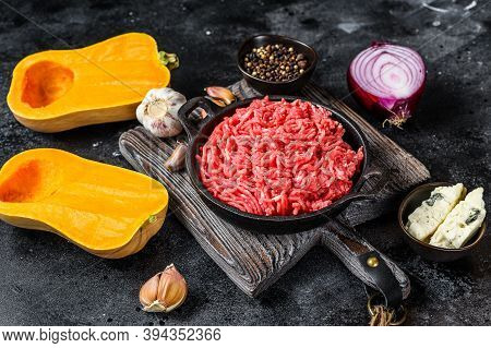 Raw Mince Meat, Pumpkin With Garlic And Onion. Black Background. Top View